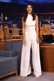 Opting for an all-white look, Victoria Justice paired her top with wide-leg pants by Sass & Bide.
