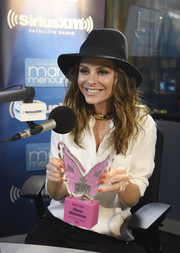 Maria Menounos channeled her inner cowgirl with this black walker hat while accepting the Victoria's Secret 'Sexiest Smile' award.