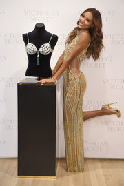 Jasmine Tookes was all aglow in gold slingbacks and an embellished gown at the Victoria's Secret Bright Night Fantasy Bra reveal.