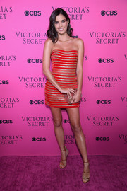 Sara Sampaio was festive and sexy in a red and gold striped strapless dress by Aadnevik at the 2017 Victoria's Secret fashion show viewing party.