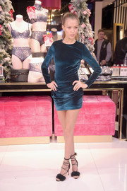 Josephine Skriver showed plenty of leg in a ruched blue velvet mini while celebrating the Victoria's Secret fashion show at the new 5th Avenue store.