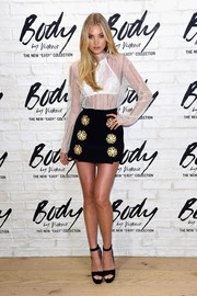 Elsa Hosk continued the flirty vibe with a flower-embellished mini skirt by Dolce & Gabbana.