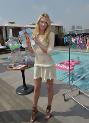 Candice Swanepoel attended the Victoria's Secret 2012 swimwear launch wearing a pair of strappy brown leather sandals.