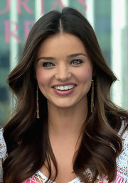 Miranda Kerr wore her hair in smooth waves while promoting Victoria's Secret 2012 swimwear collection.
