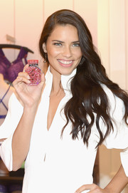 Adriana Lima looked gorgeous wearing her long waves swept to the side at the Victoria's Secret Bombshell Miami event.