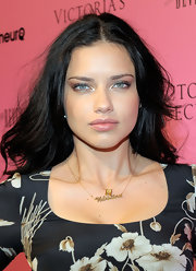 Adriana Lima wore a gold pendant necklace with her daughters name engraved on it.