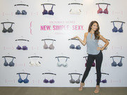 Lily Aldridge attended a Victoria's Secret event wearing a sleeveless gray keyhole-neckline blouse.