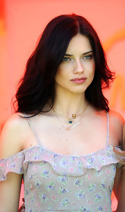 Adriana accessorized her floral frock with layered gold necklaces.