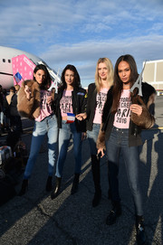 Joan Smalls headed to Paris for the 2016 Victoria's Secret fashion show wearing an edgy-glam fur and leather jacket.