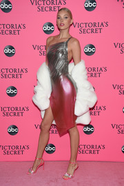 Elsa Hosk teamed a white fur coat with an ombre chainmail dress for the Victoria's Secret viewing party.