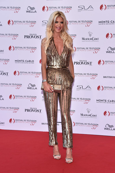 Victoria Silvstedt Metallic Clutch [clothing,red carpet,carpet,fashion model,fashion,hairstyle,premiere,long hair,shoulder,footwear,monte-carlo,monaco,monte carlo tv festival,opening ceremony,monte carlo tv festival opening ceremony,victoria silvstedt]