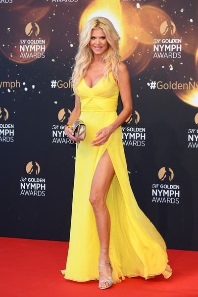 Victoria Silvstedt Evening Sandals [red carpet,dress,clothing,yellow,carpet,gown,shoulder,hairstyle,fashion,blond,victoria silvstedt,awards,golden nymph,monte-carlo,monaco,closing ceremony,monte carlo tv festival,closing ceremony]