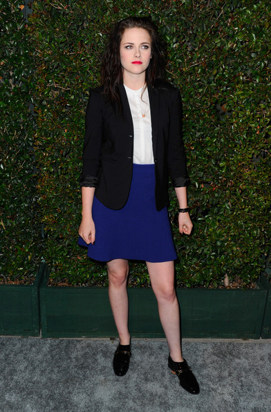 Kristen Stewart completed her look with black patent slip-ons.
