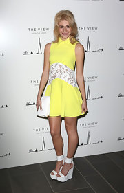 Never mind the fact it's winter -- Pixie looked like a summer darling in this yellow collared frock and white platform sandals.