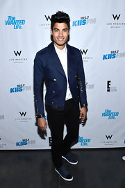 Siva Kaneswaran chose a dark navy blazer for his look at the premier of 'The Wanted Life.'