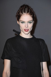 For her beauty look, Coco Rocha embraced color, pairing emerald eyeshadow with a deep-red lip.