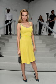 Petra Nemcova brought a bright pop to the Viktor & Rolf Couture show with this summery yellow dress.