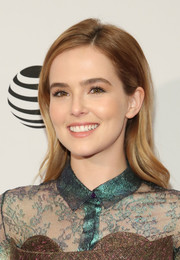 Zoey Deutch looked oh-so-pretty with her gently wavy, side-parted hairstyle at the Tribeca Film Fest premiere of 'Vincent N Roxxy.'