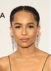 Zoe Kravitz looked groovy with her center-parted, braided bun at the Tribeca Film Fest premiere of 'Vincent N Roxxy.'