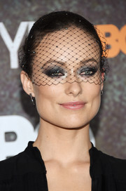 Olivia Wilde contrasted her edgy eye makeup with a soft pink lip.