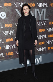 Tali Lennox attended the 'Vinyl' New York premiere rocking an all-black duster, leather jacket, and dress combo.