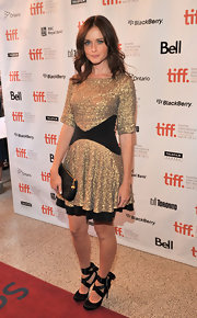 Alexis Bledel donned a glittering gold dress at the Toronto Film Festival. She paired the look with black satin pumps with ballet-inspired ribbon detailing.
