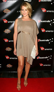 TV personality Lo Bosworth attended the Virgin America Official Sunset Strip Music Festival wearing gold Swarovski crystal heels.