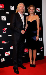 Holly Branson attended the Virgin Games Charity Gala wearing a black cocktail dress with blue satin contrast.