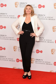 Kim Cattrall teamed a white blazer with a black jumpsuit for a relaxed yet stylish looking during the Virgin TV BAFTA Television Awards.