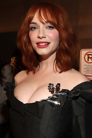 Christina Hendricks added a pop of color to her flawless look with a red lip stain.