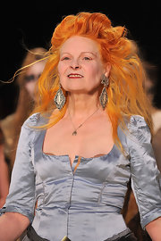 Vivienne Westwood finished off her dramatic ensemble at her Fall 2012 fashion show with a huge pair of dangling decorative earrings.