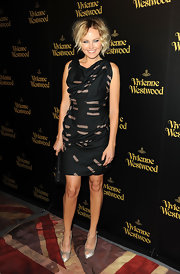 Malin Akerman paired her sexy Vivienne Westwood dress with ivory satin platform peep toes.