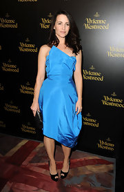 Kristin is vibrant at the Vivienne Westwood store opening party in an asymmetrical taffeta cocktail dress.