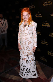 Vivienne Westwood wore a white lace evening dress to the opening of her store.