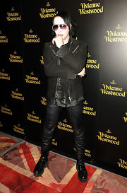 Marilyn Manson maintained his edgy signature look with black leather combat boots.