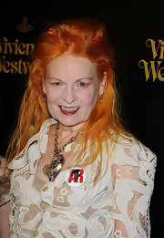 Vivienne Westwood accessorized with an eye-catching heart pendant necklace during the opening of her store.
