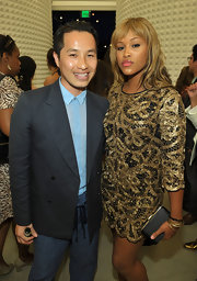 Eve complemented her super-chic dress with a simple black satin clutch at the 3.1 Phillip Lim store anniversary party.