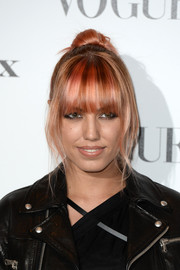 Amber Le Bon wore her coral locks in a loose bun with eye-grazing bangs when she attended the Vogue 100: A Century of Style event.