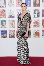 Erin O'Connor exuded vintage glamour in a deep-V floral gown with puffed sleeves at the Vogue 100 Festival Gala.