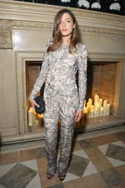 Eleonora Carisi teamed her jumpsuit with a black hard-case clutch.