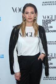 Jesinta Campbell arrived for the Vogue American Express Fashion's Night Out in Melbourne wearing a black moto jacket over a long-sleeve tee.