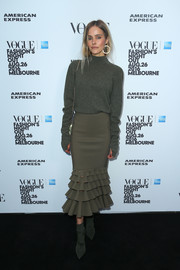 Isabel Lucas looked cozy in an army-green turtleneck while attending the Vogue American Express Fashion's Night Out in Melbourne.