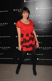 Sadie Frost looked adorable in a red and black baby doll dress at the Vogue Bulgari 125th Anniversary Party in London.