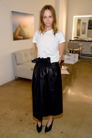 Stella McCartney jazzed up her tee with a black ruffle-waist maxi skirt.