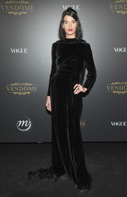 Crystal Renn kept it simple and classic in a black velvet column dress at the Vogue party in Paris.