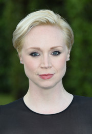 Gwendoline Christie wore her short hair with a side part and brushed back from her face when she attended the Wimbledon party.