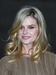 Alice Eve was sweetly coiffed with windblown waves when she attended the Wimbledon party.
