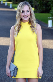 Joanne Froggatt teamed a gray suede envelope clutch with a yellow mini, both by Ralph Lauren, for the Wimbledon party.