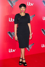 Jennifer Hudson cut a shapely silhouette in a form-fitting Altuzarra LBD adorned with gold buttons down the side during the 'Voice' UK press launch.