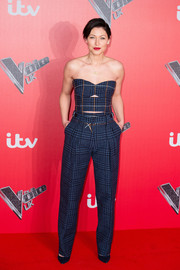 Emma Heming Willis flaunted her toned physique in a skintight cutout tube top by Victoria Beckham at the 'Voice' UK press launch.